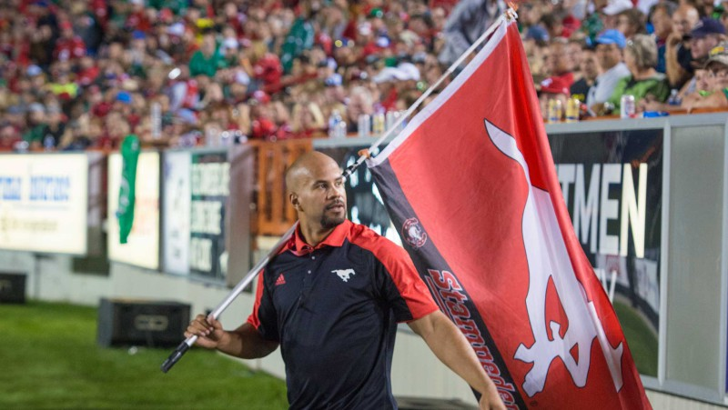 Jon Cornish pumps up the crowd during a Stamps game (Photo by Mark Shannon)