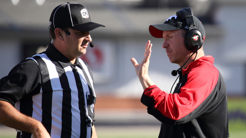 Head coach Dave Dickenson talks to a referee during the 2016 season (Photo by David Moll)