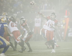 Calgary Stampeders quarterback Bo Levi Mitchell (19) throws in the fog during the second half of CFL action against the Winnipeg Blue Bombers, in Winnipeg, Friday, Oct. 26, 2018. THE CANADIAN PRESS/John Woods