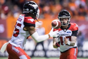 Calgary Stampeders quarterback Bo Levi Mitchell, back right, tosses the ball to Don Jackson during the first half of a CFL football game against the B.C. Lions in Vancouver, on Saturday November 3, 2018. THE CANADIAN PRESS/Darryl Dyck
