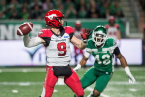 Calgary Stampeders quarterback Nick Arbuckle (9) looks for a receiver under pressure from Saskatchewan Roughriders linebacker Micah Teitz (43) during second half CFL action in Regina on Saturday, July 6, 2019. The Calgary Stampeders defeated the Saskatchewan Roughriders 37-10. THE CANADIAN PRESS/Matt Smith