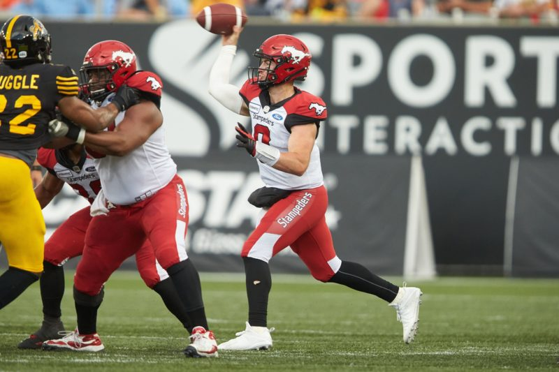 Calgary quarterback Nick Arbuckle shows a pass during second quarter CFL action between the Stampeders and the Hamilton Tiger-Cats in Hamilton, Ontario on Saturday July 13, 2019  (CFL PHOTO - Geoff Robins )