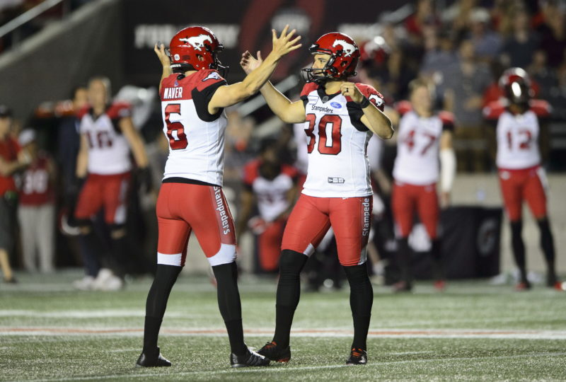 Calgary Stampeders kicker Rene Paredes, right, celebrates his game winning kick with teammate Rob Maver as they took on the the Ottawa Redblacks during second half CFL action in Ottawa on Thursday, July 25, 2019. The Stamps took the Redblacks 17-16. THE CANADIAN PRESS/Sean Kilpatrick