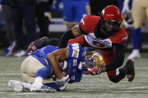 Winnipeg Blue Bombers' Kenny Lawler (89) makes the catch as Calgary Stampeders' DaShaun Amos (8) defends during the second half of CFL action in Winnipeg Friday, October 25, 2019. THE CANADIAN PRESS/John Woods