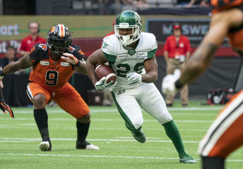 Saskatchewan Roughriders William Powell (right) gets past B.C. Lions' Davon Coleman during 1st quarter CFL action in Vancouver on Saturday, July 27, 2019.  (CFL PHOTO - Richard Lam)