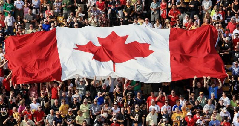Canada flags fly during the National Anthem for CFL action between the Winnipeg Blue Bombers and Hamilton Tiger Cats in Hamilton, Ontario on Canada Day, Friday, July 1, 2011.  (CFL PHOTO - Dave Chidley)