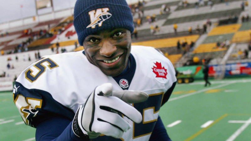 Winnipeg Blue Bombers slotback Milt Stegall jokes with photographers as he leaves the field after the Bombers defeated the Hamilton Tiger Cats 28-7 during  CFL action in Hamilton Sunday Oct. 27, 2002. Stegall caught his 23rd touchdown to break the league record for most touchdowns in a season. (CP PHOTO/Kevin Frayer)