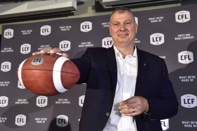 Randy Ambrosie holds a football as he speaks during a press conference in Toronto, Wednesday July 5, 2017. The CFL says Ambrosie will serve as the 14th commissioner in league history. THE CANADIAN PRESS/Frank Gunn