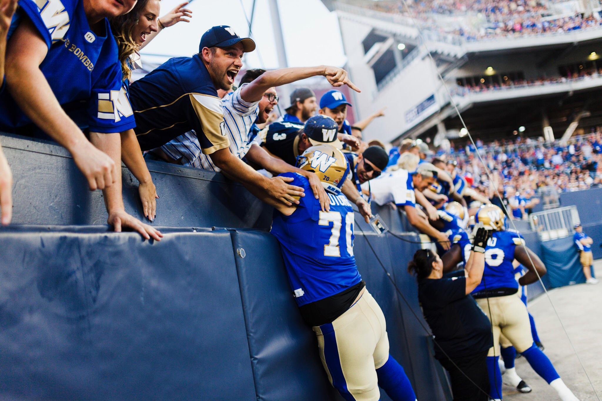 Winnipeg Blue Bombers jump into the crowd