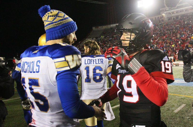 Blue Bombers' Matt Nichols greats Stampeders' Bo Levi Mitchel after the game, CFL, West Final action in Calgary, AB, on Sunday,  Nov. 18th, 2018.  (CFL PHOTO - Dave Chidley)