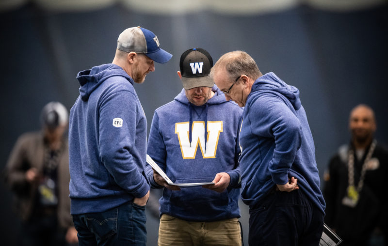 Winnipeg Blue Bombers general manager Kyle Walters, head coach Mike O'Shea and assistant GM Ted Goveia during the CFL combine at the Varsity Stadium in Toronto, ON, Sunday, March 24, 2019. (Photo: Johany Jutras/CFL)
