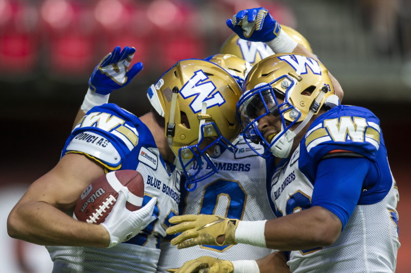 Winnipeg Blue Bombers' Drew Wolitarsky (82) celebrates his touchdown against the B.C. Lions with teammates Nic Demski (10) and Anthony Gaitor (23) during the second half CFL football action in Vancouver, B.C., on Saturday June 15, 2019. THE CANADIAN PRESS/Ben Nelms