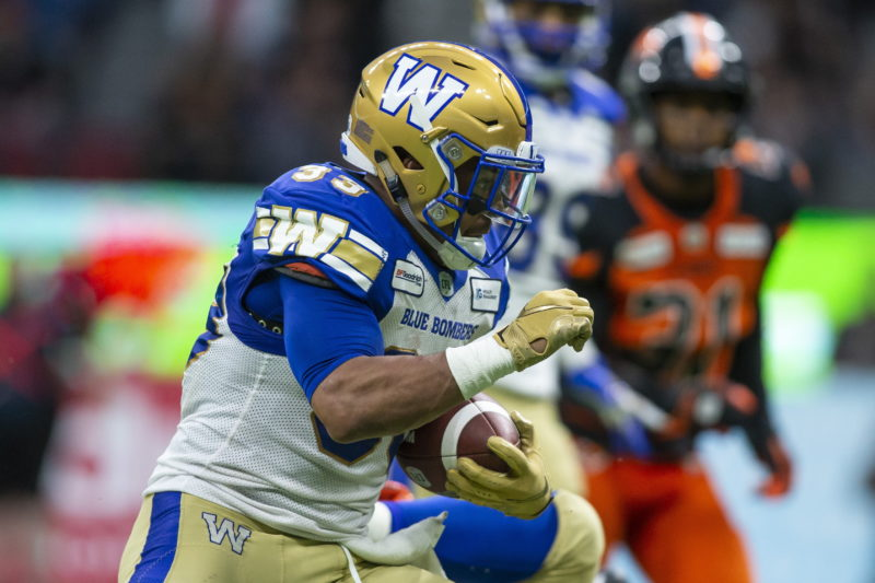 Winnipeg Blue Bombers' Andrew Harris (33) runs the ball against the B.C. Lions during the second half of CFL football action in Vancouver, B.C., on Saturday June 15, 2019. THE CANADIAN PRESS/Ben Nelms
