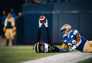 Brandon Banks (16) of the Hamilton Tiger-Cats and Marcus Rios (39) of the Winnipeg Blue Bombers during the CFL game between the Winnipeg Blue Bombers and the Hamilton Tiger-Cats at Investors Group Field in Winnipeg, MB on Friday Sept. 27, 2019. (Photo: Johany Jutras / CFL)