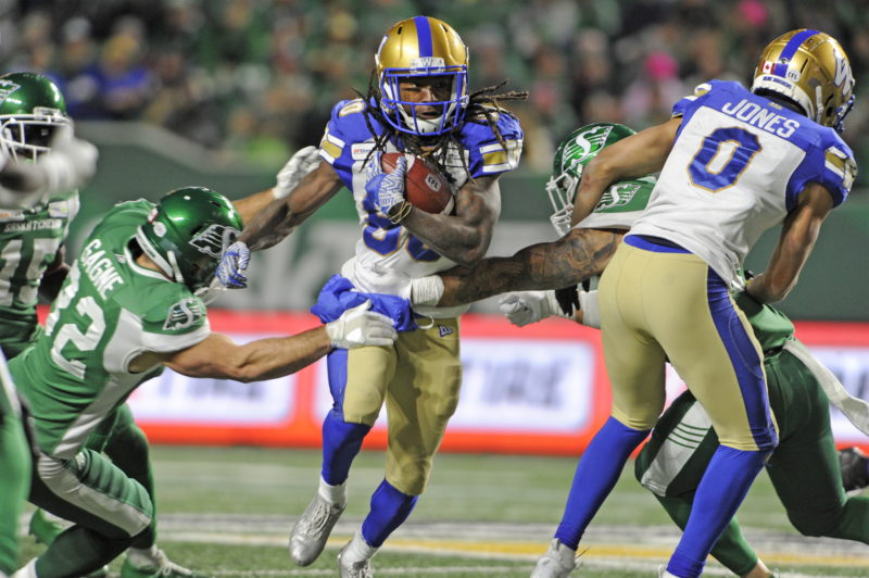 Winnipeg Blue Bombers wide receiver Janarion Grant splits a tackle during second half CFL action against the Saskatchewan Roughriders, in Regina on Saturday, Oct. 5, 2019. THE CANADIAN PRESS/Mark Taylor