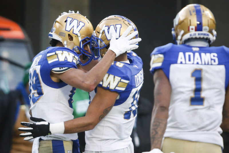 Winnipeg Blue Bombers' Kenny Lawler, left, celebrates his touchdown with teammate Nic Demski during CFL West Final football action against the Saskatchewan Roughriders in Regina, Sunday, Nov. 17, 2019.THE CANADIAN PRESS/Jeff McIntosh