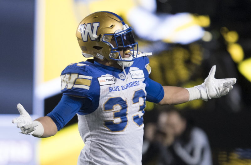 Winnipeg Blue Bombers' Andrew Harris celebrates his touchdown against the Hamilton Tiger-Cats during the first half of the 107th Grey Cup in Calgary, Alta., Sunday, November 24, 2019. THE CANADIAN PRESS/Nathan Denette