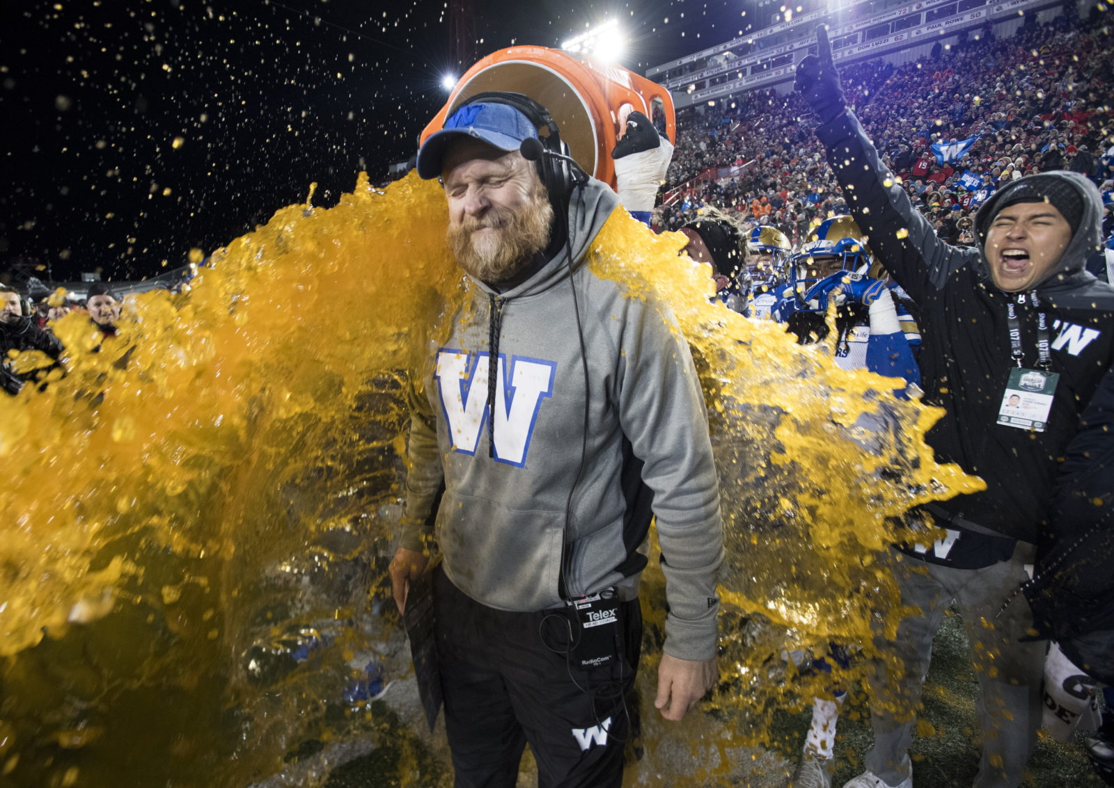 Winnipeg Blue Bombers head coach Mike O'Shea gets a sports drink poured over him as his team defeats the Hamilton Tiger Cats in the 107th Grey Cup in Calgary, Alta., Sunday, November 24, 2019. THE CANADIAN PRESS/Frank Gunn