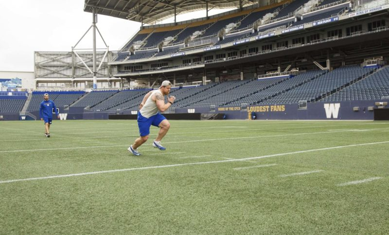 MIKE DEAL / WINNIPEG FREE PRESS Winnipeg Blue Bombers' Adam Bighill (4) does some running drills on the field at Investors Group Stadium Friday morning. see Taylor Allen story 200529 - Friday, May 29, 2020.