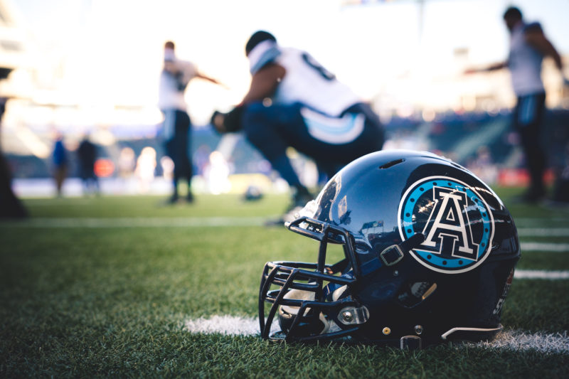 A Toronto Argonauts helmet on the field turf before the game against the Winnipeg Blue Bombers at Investors Group Field in Winnipeg, MB., on Thursday, July 13, 2017. (Photo: Johany Jutras)