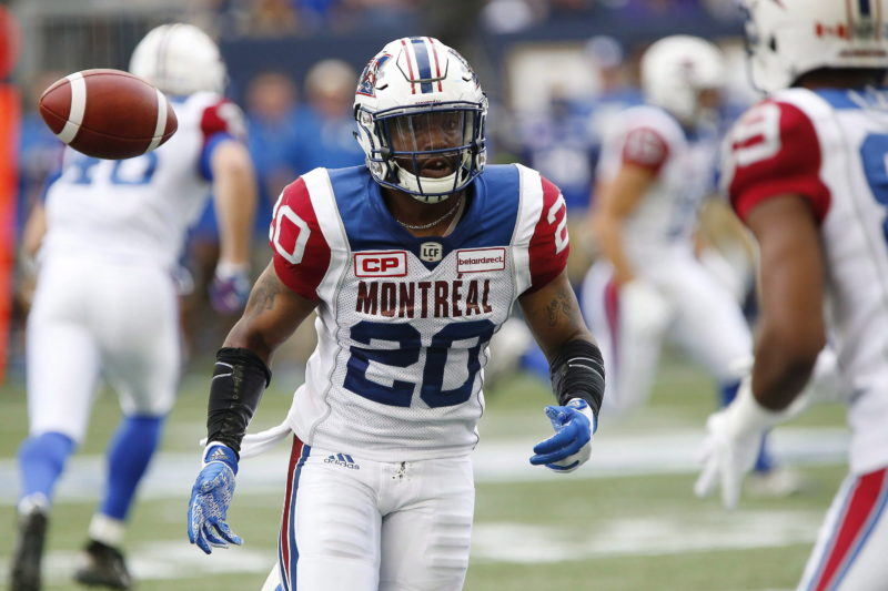 Montreal Alouettes' Tyrell Sutton (20) laterals to Duron Carter (89) during the first half of CFL action against the Winnipeg Blue Bombers in Winnipeg Friday, June 24, 2016. THE CANADIAN PRESS/John Woods