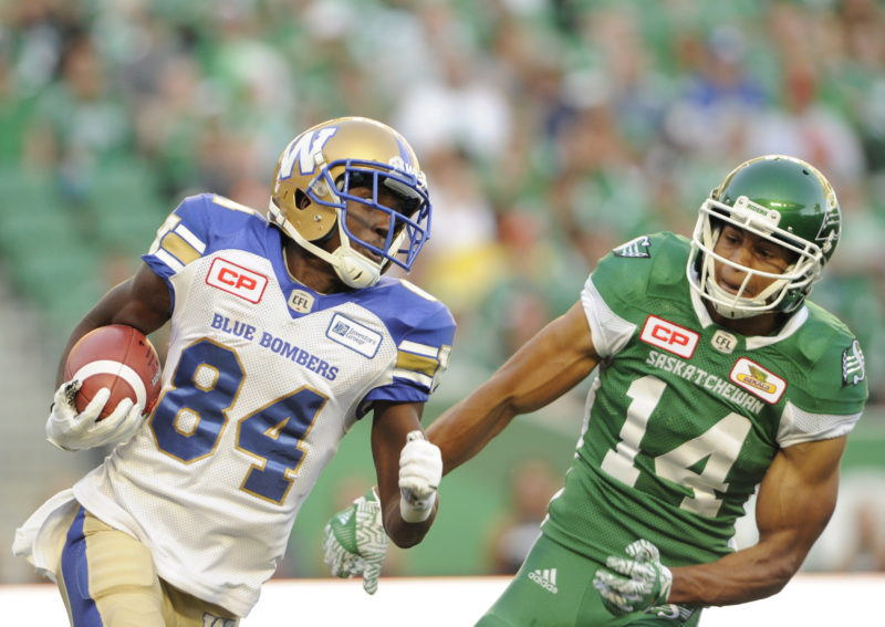 Winnipeg Blue Bombers wide receiver Ryan Lankford moves the ball upfield under pressure from Saskatchewan Roughriders wide receiver Denzel Radford during first half CFL action at the brand new Mosaic Stadium in Regina on Saturday, July 1, 2017. THE CANADIAN PRESS/Mark Taylor