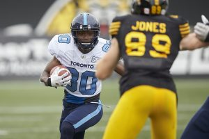 Toronto's Kurleigh Gittens Jr. runs the ball during the third quarter of the CFL's Labour Day Classic between the Argonauts and the Hamilton Tiger-Cats in Hamilton, Ontario on Monday, September 2, 2019  (CFL PHOTO - Geoff Robins )