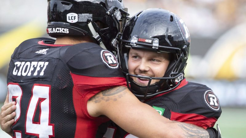 Ottawa Redblacks kicker Lewis Wardduring is hugged by teammate Anthony Cioffi after his final field goal of the game during second half CFL football game action against the Hamilton Tiger-Cats in Hamilton, Ont. on Saturday, July 28, 2018. THE CANADIAN PRESS/Peter Power