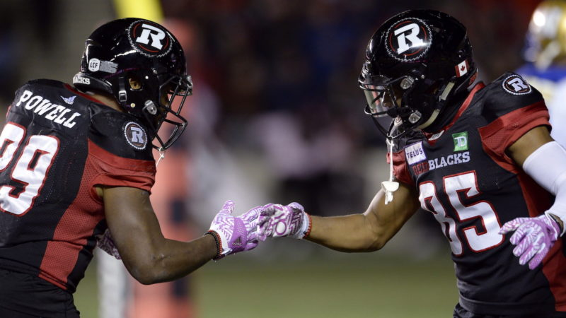 Ottawa Redblacks running back William Powell (29) and teammate Diontae Spencer (85) celebrate after Powell's touchdown during first half CFL football action against the Winnipeg Blue Bombers, in Ottawa on Friday, Oct. 5, 2018. THE CANADIAN PRESS/Adrian Wyld
